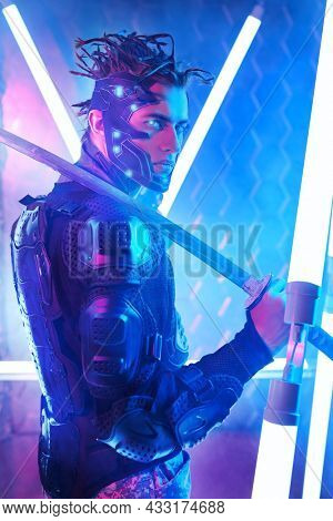 A brave sci-fi cyborg samurai man in a protective suit fights with sword in his hand in neon light. Cyberpunk world. Game, virtual reality.