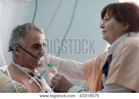 Doctor Setting Oxygen Mask