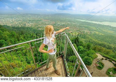 Woman By Zurich Cityscape On A Swiss Lookout Tower On Uetliberg Mountain In Swiss Plateau Of Switzer