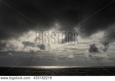Storm Clouds Over The Sea. Reflections Of The Sun In The Sea Water. Holiday Landscape.
