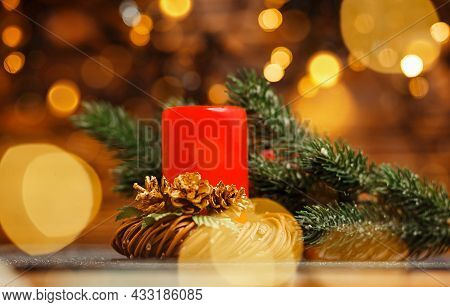 Colorful Bokeh. Golden Xmas. Flame Candles With Decorative Lights. Christmas Candles And Lights. Bur
