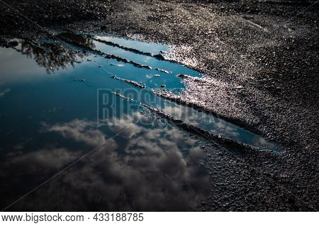 Reflection Of Blue Sky And Clouds In A Puddle | Blue Sky With Clouds Reflecting In A Big Puddle With