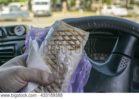 Food, Fresh Shawarma In The Hand Of A Car Driver Who Is Sitting At The Wheel And Is Ready To Have Lu