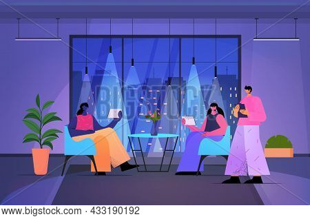 Businesspeople Using Digital Gadgets Business People Working In Modern Dark Night Office Horizontal