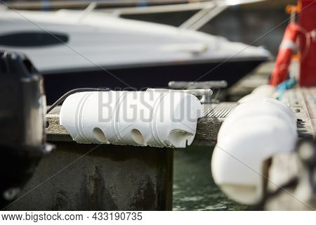 Long Pier Blue Fenders For A Boat And Dockside For Protection. Maritime Fenders