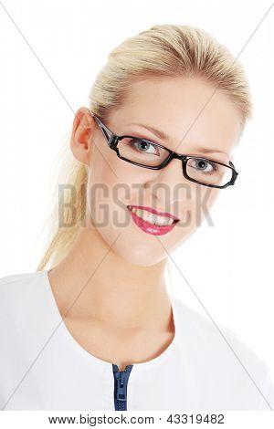 Smiling medical doctor or nurse. Isolated on white background