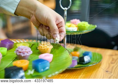 Thai Chef's Hand Is Decorating Varieties Traditional Colorful Thai Desserts Set Steaming Flour, Blac