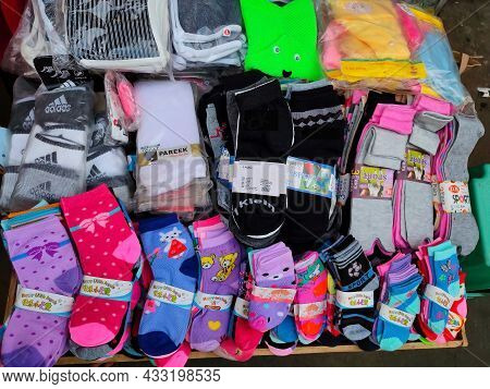 Kolhapur,india- December 5th 2020; Stock Photo Of Colorful Woolen Kids Socks And Shoes At Street Gar