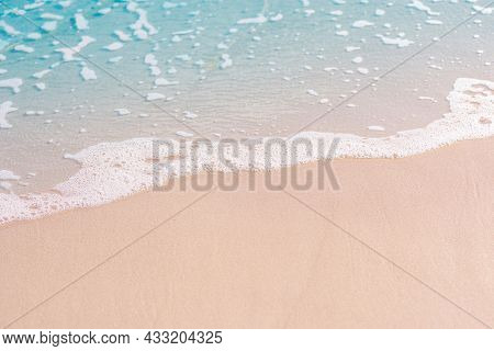 The Beach And Sand With The Blue Water And Foaming Wave In The Tropical Beach In Thailand