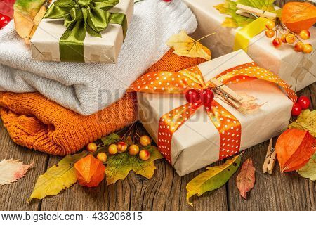 Zero Waste Gift Concept With Autumn Design. Warm Sweaters, Fall Leaves, Thematic Decor