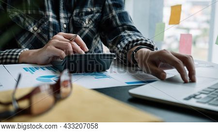 Business Woman Using Calculator For Do Math Finance On Wooden Desk In Office And Business Working Ba