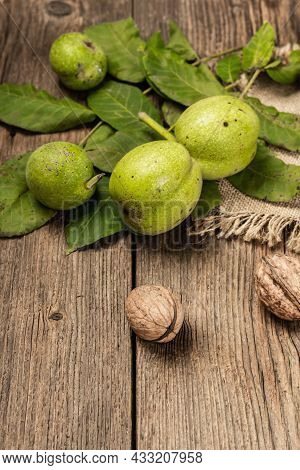 Ripe Brown And Unripe Green Walnuts On Sackcloth Napkin
