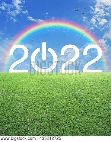 2022 Start Up Business Flat Icon With Green Grass Field Over Rainbow, Birds And Blue Sky With White