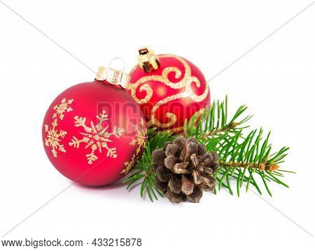 Red And Golden Christmas Balls With Branch Of Fir Tree And Cone On A White Background. Set Of Christ