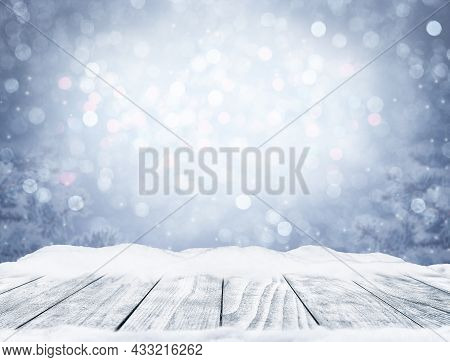 Winter Decorative Christmas Background With Bokeh Lights, Snowflakes And Empty Old Wooden Table. Chr