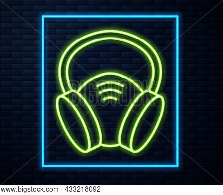 Glowing Neon Line Gas Mask Icon Isolated On Brick Wall Background. Respirator Sign. Vector