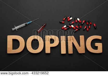 Word Doping Of Wooden Letters With Drugs On Black Background, Flat Lay