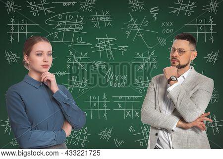 Businesspeople Near Green Chalkboard With Drawn Tic Tac Toe Game