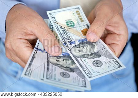 Us Dollars In Male Hand Close Up, Man In Business Clothes Counting The Money. Concept Of Bribe, Sala