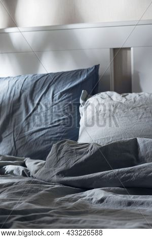 Empty Messy Bed With Pillows In The Moonlight. Darkness And Evening Rituals For Healthy Sleep.