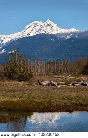 Mt. Garibaldi Squamish Estuary Reflection. The Reflection Of Mt. Garibaldi Looking Over The Squamish