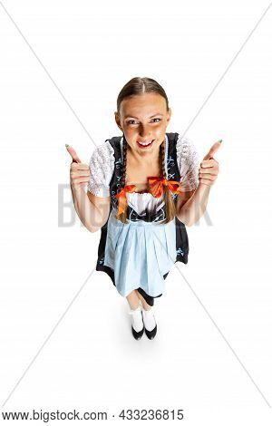 High Angle View Of Sexy Oktoberfest Woman, Waitress Wearing A Traditional Bavarian Or German Dirndl