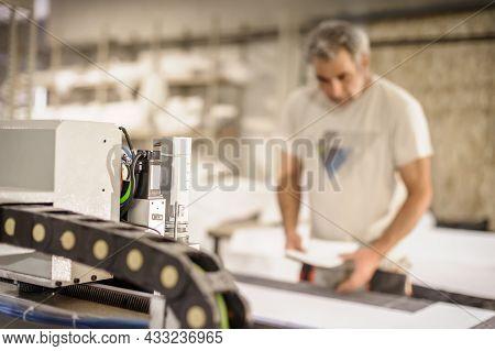 Technician Works On Cnc Digital Cutter Machine For Cutting Textile