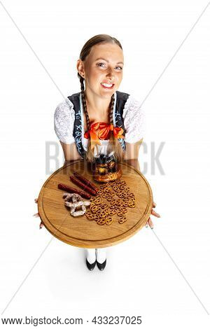 Elevated View Of Sexy Oktoberfest Woman, Waitress Wearing A Traditional Bavarian Or German Dirndl Is