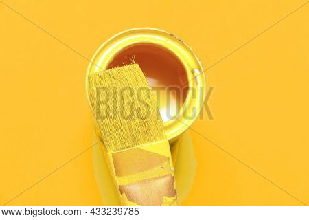 Yellow Paint And Yellow Paint Brush With Yellow Backround Color
