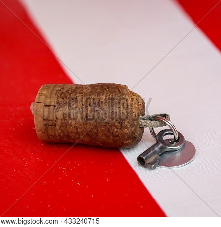 A Key For A Lock, Padlock On A Red White Plastic Pad.