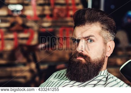 Brutal Serious Young Bearded Man. Barbershop, Lifestyle And People Concept. Bearded Man At Barber Sh