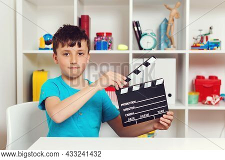 School Boy Holding Black Film Making Clapperboard. Producer Making Film. New Idea For School Project
