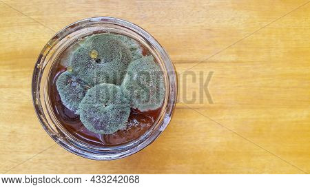 Mold On Fig Jam In A Jar Top View. Mold Spores On Preservation. Spoiled Jam In A Glass Jar. A Poison
