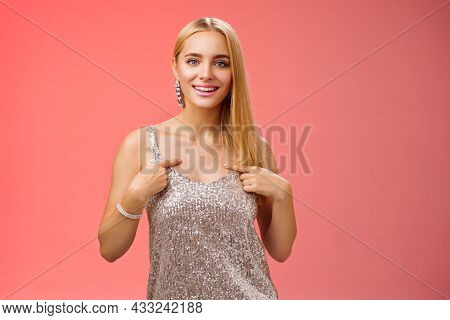 Boastful Good-looking Confident Blond European Woman In Silver Luxurious Dress Pointing Herself Smil