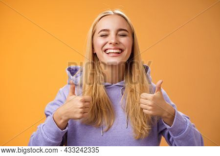 Close-up Carefree Delighted Positive Lucky Young Blond Woman In Hoodie Close Eyes Joyfully Celebrati