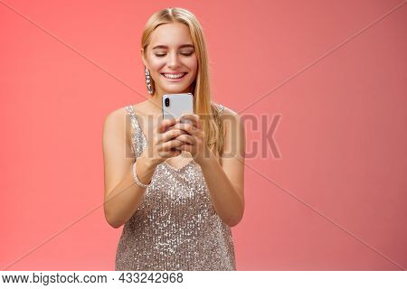 Delighted Tender Glamour Blond Woman In Silver Stylish Glittering Dress Brilliand Earrings Holding S