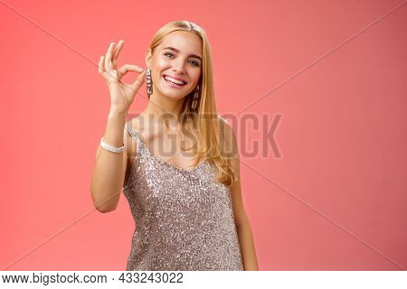 Optimistic Attractive Stylish Blond Woman In Silver Dress Show Okay Ok Gesture Smiling Broadly Give
