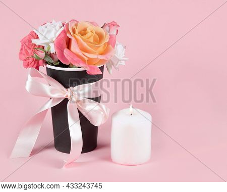 Bouquet Of Rose Flowers And Candle Burning On Pink Background.  Copy Space