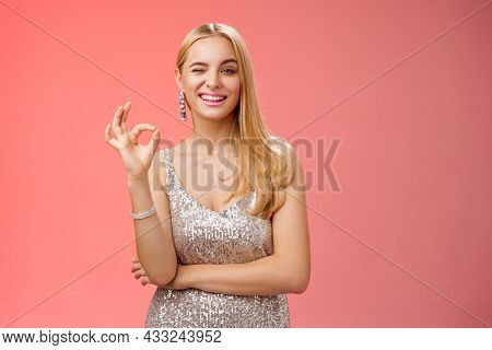 Sassy Blond Young Woman In Stylish Luxury Silver Dress Winking Take Things Under Control Show Okay N