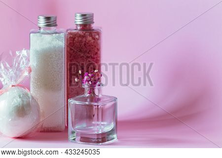 White Beads, Pink Shimmer, Bath Bomb Stand On A Purple Background. High Quality Photo