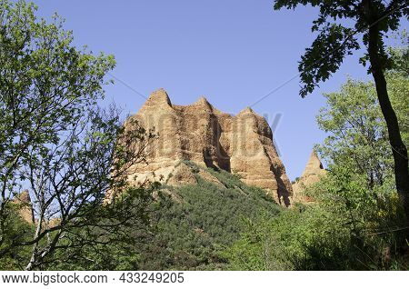 View From Below Of A Red Mountain, Ancient Gold Mine. Las Médulas, León, Spain, Europe