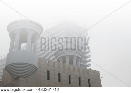 Low Angle View Of A Modern Architecture Details During Foggy And Misty Weather