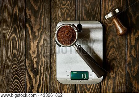 Accurate Scale And Portafilter With Ground Coffee, Espresso Recipe Concept, Wooden Background With C