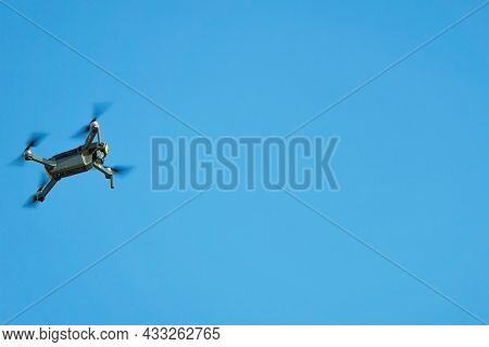 The Copter Flies Against The Background Of A Clear Clear Sky. Сopter In Motion. Drone Flight.