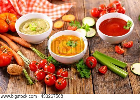 assortment of colored vegetable soup and ingredients