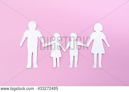 Paper Family Cut Out On Bright Pink Background. Family Home, Foster Care, Family Mental Health, Divo