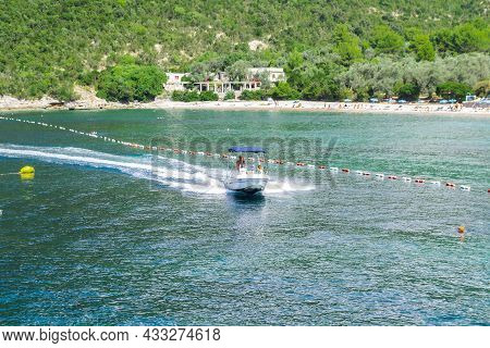 Budva, Montenegro, July 18, 2021: A Man On A Yacht With Girls At Sea In The Bay Of Kotor. In The Bac