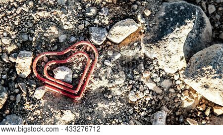 Broken Paper Clip Lying On The Dirty Lane.  Symbol Photo For Getting Divorced.
