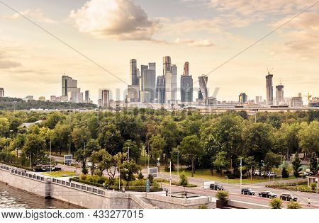 Moscow In Summer, Russia. Scenic Panorama Of Luzhniki Park And Moscow-city Tall Buildings In Distanc