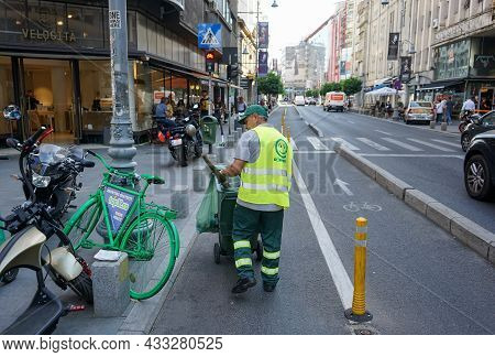 Bucharest, Romania - Septemeber 13, 2021: A Sweeper Employee Of Romprest Cleaning Company Is Working